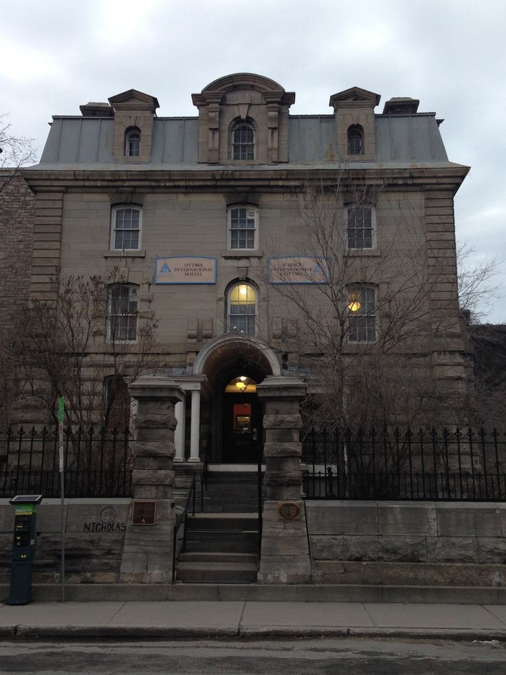 """Hi-Ottawa Jail Hostel in Ottawa, ON - When the jail, which was operated from 1862 to 1972 was finally closed, Hostelling International purchased the building and opened the hostel one year later, leaving much of the original structure intact in order to allow guests a unique experience of spending a night in """"jail."""" But those who stay at the hostel might just be getting a far deeper, and far darker experience than just the novelty of sleeping in an old converted jail cell."""