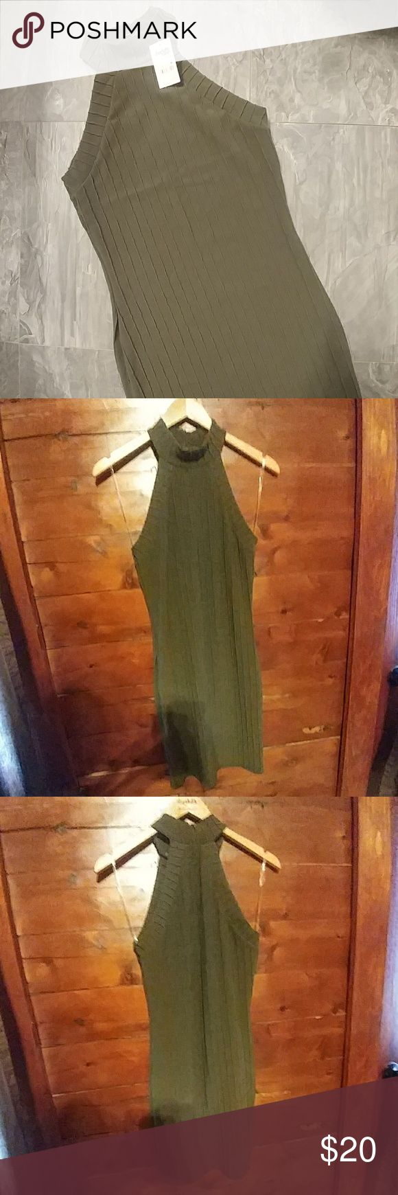 Olive Green Bodycon *NWT* Olive green bodycon great for a night out!  Material is stretchy but definitely fitted as it is a bodycon.  Material has vertical quilted stripes on it.  Mock neck, racerback.  Hits about mid thigh.   Smoke free home No trades, willing to bundle and take offers! Charlotte Russe Dresses