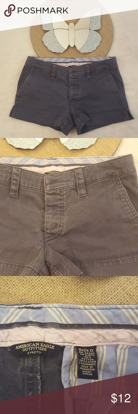 "Womens American Eagle Blue Chino Shorts 0 American Eagle Blue-gray chino short shorts. They have a clasp and 3 button fly. They are in good used condition with normal wash wear such as noticeable fading and ""pre-pilling.""  Flat across waist 13.75"" Hips 15.75"" Front Rise 6.5"" Inseam 2.5"" Cotton blend   *Butterfly not included  Storage location #252 Item #2661 American Eagle Outfitters Shorts"