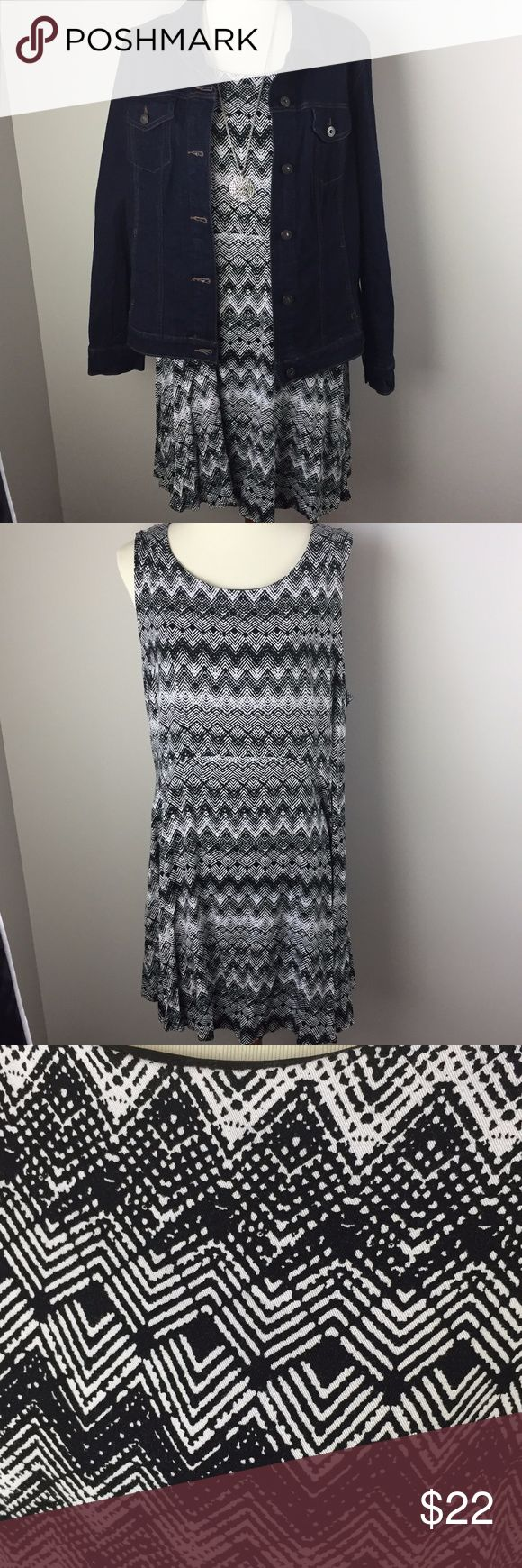 "Torrid Black & White Dress Women's Plus Size 22 This dress is lined.  Looks brand new!  So many ways to accessorize this cute dress!  Comes from a smoke-free and pet-free home.  Approximate measurements laying flat: full length: 37"", armpit to armpit: 21"", waist: 20"", waist to hem: 21"" 97% Rayon, 3% Spandex torrid Dresses"