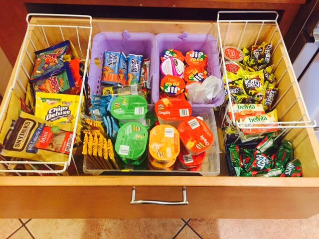 """I use a deep kitchen drawer to organize my kids' school snacks. It eliminates all those boxes that take up space in the cabinets/pantry and it allows them to find their own snacks the night before. These aren't always the most nutritious of snacks so they know that they can choose one from the """"snack drawer"""" and two from the frig where I keep cheese sticks, yogurt, cut up fruit, etc."""