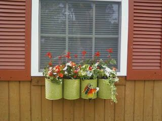 1 gallon food cans, painted and made into window box Window on