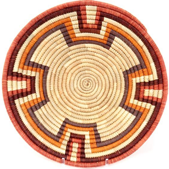 Handwoven out of Millet and Raffia, these Ugandan baskets are tightly woven compared to some other Ugandan baskets - making them a great value.