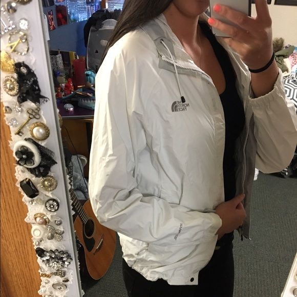 White north face rain jacket Only worn a few times! Perfect condition North Face Jackets & Coats