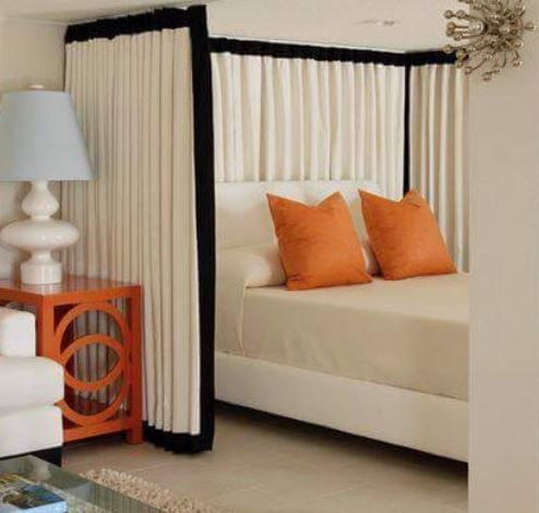 Ceiling Mounted Curtain Tracks in a bedroom