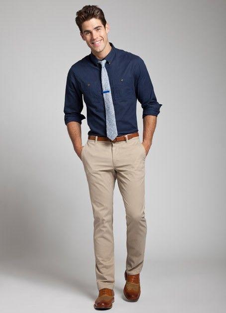 Shop this look on Lookastic:  https://lookastic.com/men/looks/long-sleeve-shirt-chinos-oxford-shoes-tie-belt/13321  — Navy Long Sleeve Shirt  — Grey Wool Tie  — Brown Leather Belt  — Beige Chinos  — Brown Leather Oxford Shoes