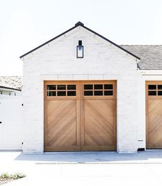 Parking is a pleasant pastime with the view of this A-patterned garage door. We love how the wood of the doors mimic the A-frame of the roofline. | Designed by Brandon Architects