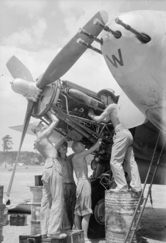 ROYAL AIR FORCE OPERATIONS FAR EAST 1941-1945 (CF 586)   Ground crew of No. 110 Squadron RAF service the starboard engine of a de Havilland Mosquito FB Mark VI at Joari, India: (left to right), Leading Aircraftman E Crandon of Nechells, Birmingham, Corporal A G Jackson of Mickleover, Derbyshire, Leading Aircraftman G Simpson of Feltham, Middlesex and Aircraftman C N King of Tottenham, London.