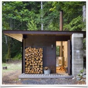 Wood stack against dark wall modern rustic cabin designed by Olson Kundig Architects // @Alice Alkire Heiple !