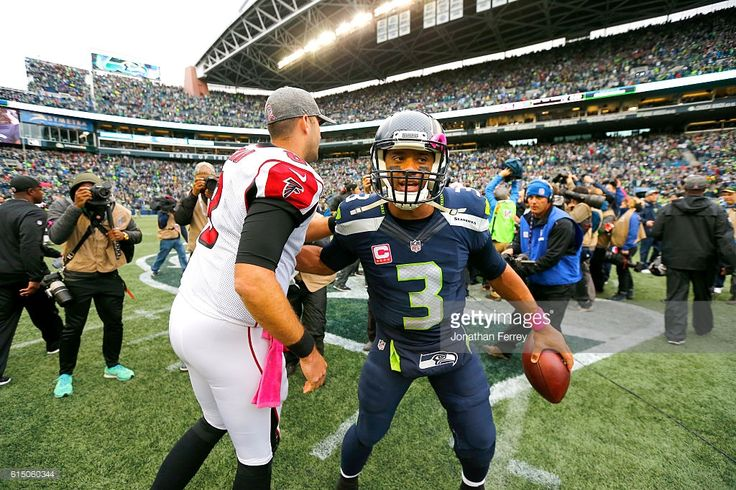 Quarterback Russell Wilson #3 of the Seattle Seahawks greets Quarterback Matt Ryan #2 of the Atlanta Falcons at the end of the game at CenturyLink Field on October 16, 2016 in Seattle, Washington.