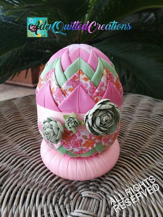 Quilted Easter eggs to decorate your home this holiday season. Light pastel coloured cotton fabrics were used folded to craft these ornaments. Size: height-12 cm (4.72 inches) and perimeter -27 cm (10.65 inches). These are a lot larger than an actual egg, which is approximately