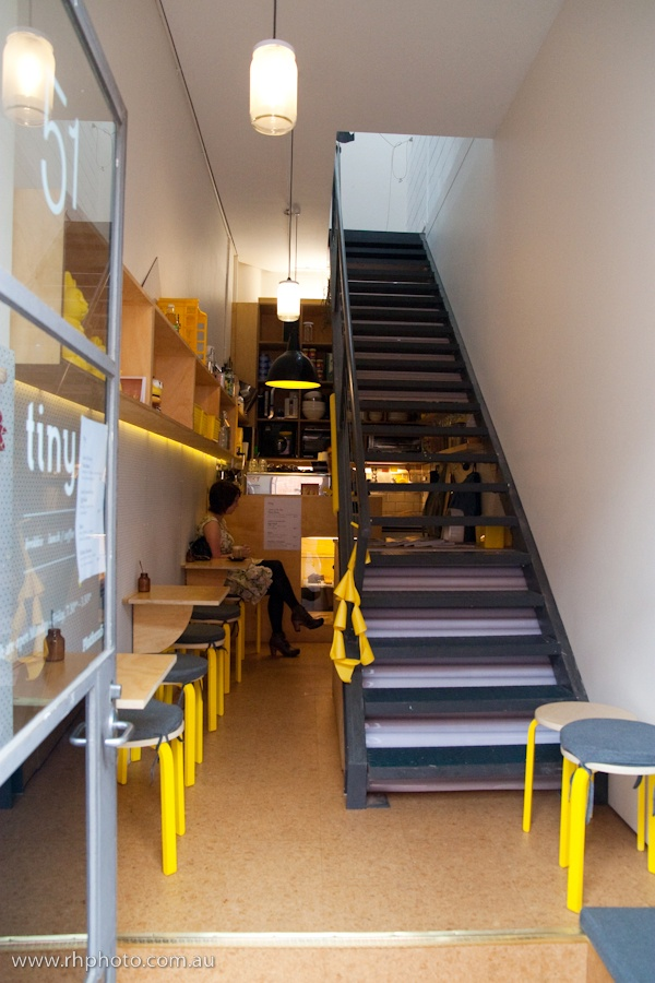 Clever furniture and a limited pallet give this small #cafe a more spacious feel.Tiny #Cafe Melbourne