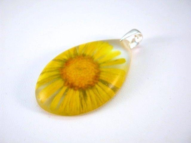 Flower of Marigold preserved in resin. http://en.dawanda.com/product/48854886-Anhaenger---Ringelblume---925-Silber