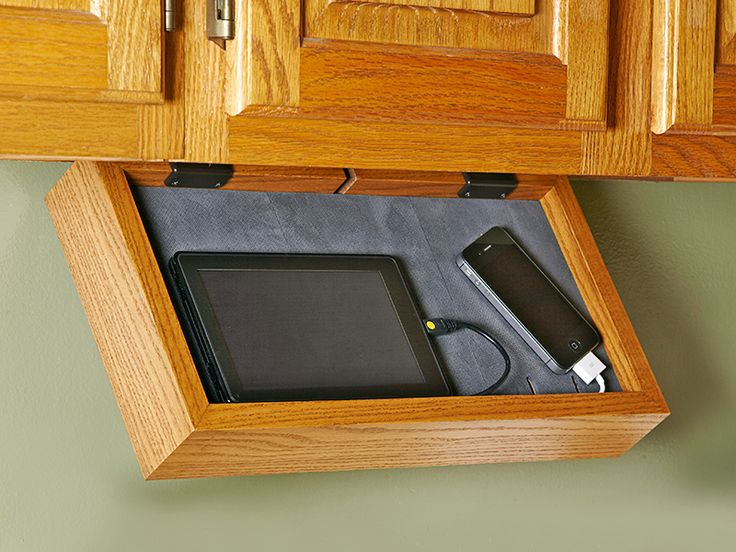 Phone-charging Station.  If your kitchen counter turns into a rat's nest of charging cords for your family's cell phones, MP3 players, and tablet computers every night, then you need this discreet under-cabinet electronics valet. It mounts easily beneath a kitchen cabinet, hinges down for access, and includes a tip for creating a one-cord solution for charging multiple devices. http://www.woodstore.net/phst.html