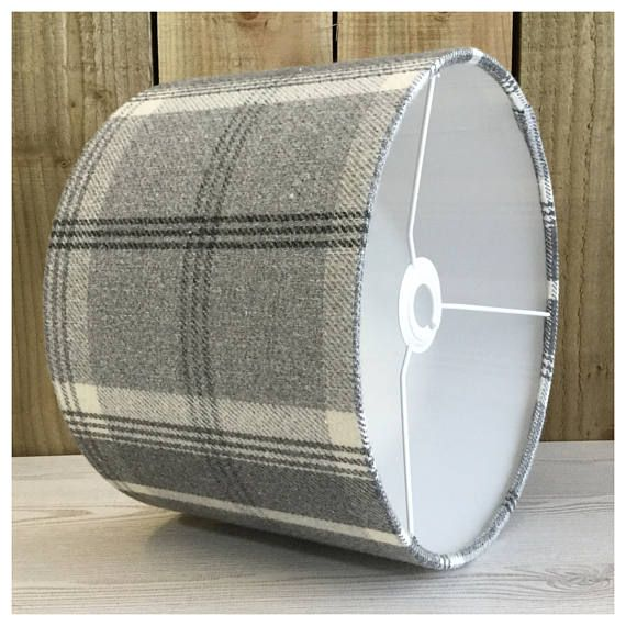 This stylish lightshade / lampshade is handmade in our Bristol workshop from a dove grey colour tartan fabric. The lightshade is also available with a diffuser, please follow the link below ▪️ Shade & diffuser - ▪️Matching cushion covers- ▪️Need a swatch of this fabric? Please order from this listing- https://www.etsy.com/uk/listing/514198455/sample-of-fabric ▪️Fabric - Dove Grey tartan fabric ▪️Made to order within 5 working days ▪️ Measures - Various...