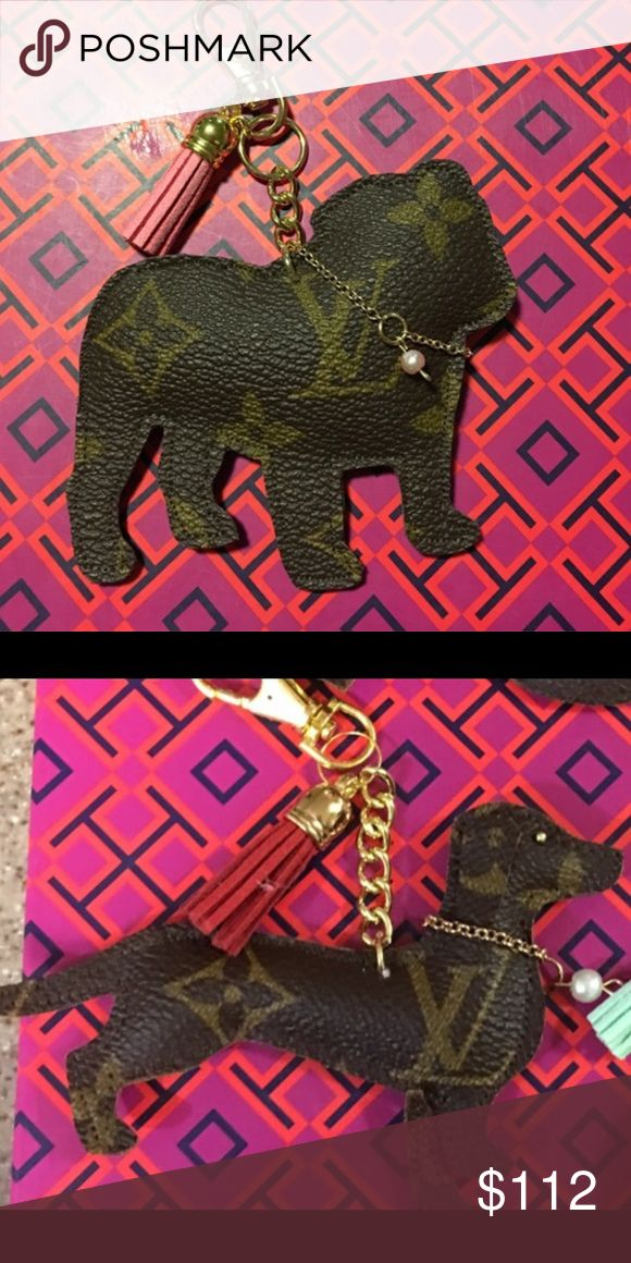 2 English Bulldogs, daschund charms Handmade from authentic Louis Vuitton canvas! All items are made from authentic purses re-purposed.   One single tassel is included with your purchase some up charges apply. Purchase the listing you want and tag me so I know what color tassel.   Please understand these are extremely tedious to make. There could be slight imperfections with any of these items. Please keep that in  Mind when you're buying.   Prices are firm, although offers are appreciated…