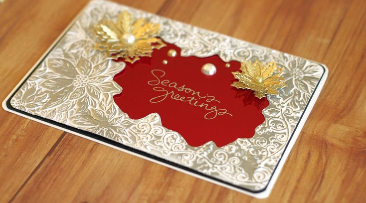 """Use your Stamps by Chloe to add even more dimension to your embossing folders! This card was created by Crystal Schneider using the """"Pretty Poinsettia"""" Embossing folderand Stamps by Chloe """"Holly Border"""" die from #crafterscompanion"""