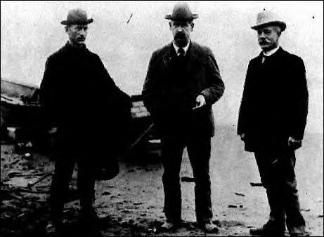 Wyatt Earp {center} in Nome, Alaska during the gold rush. He was attracted to the boom towns. John Clum is on the right. He was the mayor of Tombstone when the gunfight at the OK Corral took place. He was an ally of the Earp brothers.
