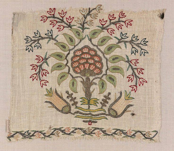 Rectangular fragment. Coarse but sheer linen twill ground, embroidered with polychrome silks and gold yarn in double running and satin stitches. Pattern shows a flowering tree rising from between a pair of large scale rosebuds. Silks faded; gold yarns tarnished and worn. Ground stained and worn; ends raveling.