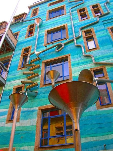 """ 'A Wall That Plays Music When It Rains' - in Dresden, Germany.     Designed by artists Annette Paul, Christoph Roßner, and André Tempel, this wall is covered with funnels and gutters and is located in Dresden's student district."""