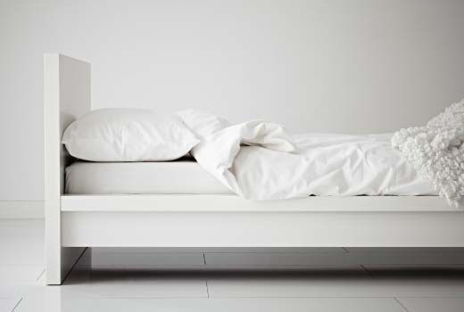 The bed I've had in mind. Almost. (Also, throw African fabric pillows on that.)  IKEA Single Beds - MALM Bed Frame