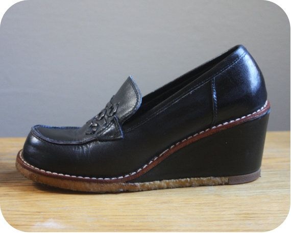 1970s  - had a pair just like this for school.  Gave me dreadful blisters, but I kept on wearing them! Got the scars to prove it