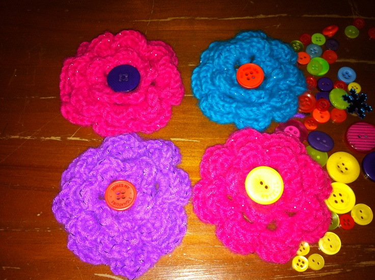 Still deciding what to do with these crochet flowers i just made. I'll either make them into head bands, or attach them to hats.   Guess I should get started on crocheting some hats now!