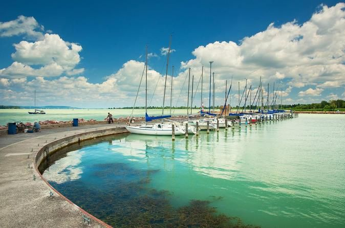 "Private All Day Lake BalatonTour From Budapest Take a memorable all day private Lake Balaton tour with a perfect guide. Make a visit to the famous cities of Tihany, Balatonfüred and Herend with a 3 course menu lunch included.Enjoy a marvellous swim and some relax in the sun. Wonderful trip in a wonderful nature!Make your travel pleasant and comfortable by using this service.The tour can be booked 24 hours a day, 7 days a week from 1 person up to 8 persons.Balaton, the ""Hungari..."