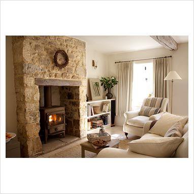 Wood burning fireplace with stone surround chimney