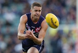 SUN-1401257 © WestPix AFL Round 3 - Fremantle Dockers vs Western Bulldogs, at Subiaco Oval, Perth. Pictured - Fremantle's Stephen Hill gets a handball away on the wing  Picture: Daniel Wilkins