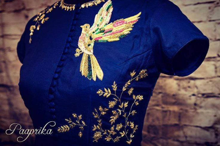 Stunning blue color crop top with lata and flying bird design hand embroidery thread work. 06 October 2017