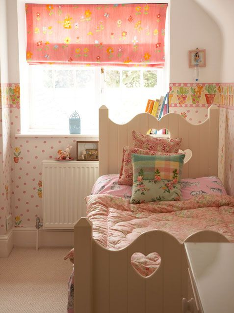 I love how the base of this room is quite neutral and that it is made girly with country style prints.