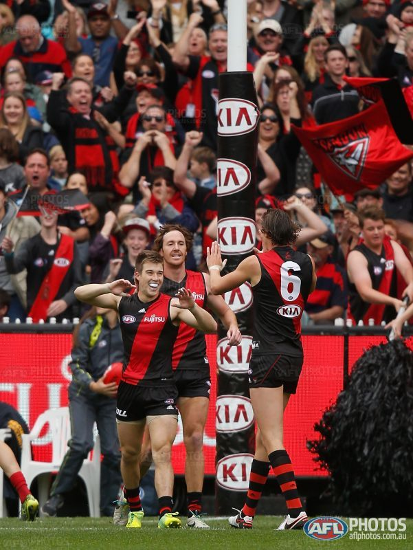Zach Merrett of the Bombers celebrates a goal during the 2016 AFL Round 02 match between the Melbourne Demons and the Essendon Bombers at the Melbourne Cricket Ground, Melbourne on April 2, 2016.