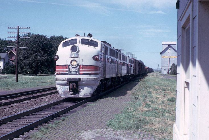 https://flic.kr/p/JfT2me | CB&Q Leland, IL -- The Depot, Passenger and Freight Trains, and More -- 18 Photos | CB&Q 153CBA (FTA, FTB, F2A) with Train 12 at 9:49 am on July 9, 1963 at Leland,IL.  I was the substitute agent at the Leland, Illinois CB&Q station for the vacationing regular agent in July 1963. Leland is on the double-track mainline between Aurora and Galesburg, about 30 miles west of Aurora. The depot is long gone.