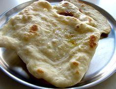 Naan on tawa or tawa naan recipe. Easy step by step recipe to make tawa naan on the stove top on an regular pan called tawa in India.