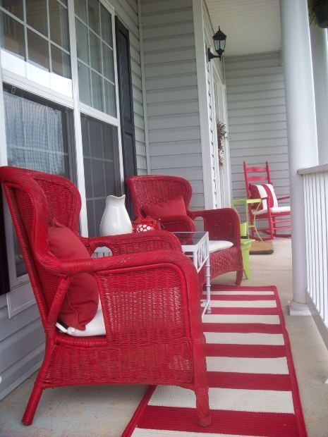 Narrow porch with great red rockers and rug
