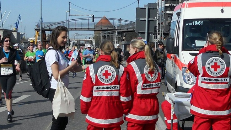 Volunteer from the Church of Scientology Hamburg hands a copy of The Way to Happiness to ambulance workers on duty at the Hamburg Marathon April 21. Read the full press release here: http://www.prweb.com/releases/2013/5/prweb10757128.htm