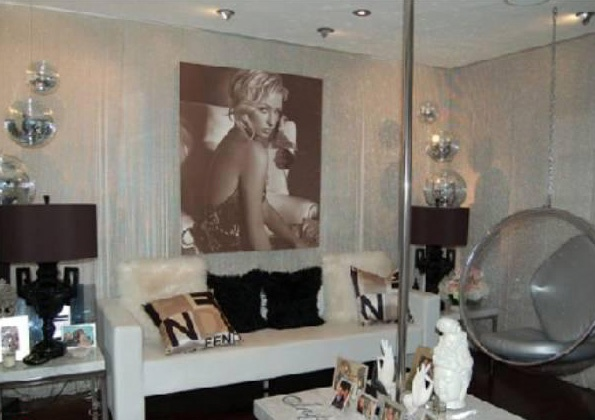 Paris' former home in Beverly Hills. Available for lease for 16k a month. She has a stripper pole coffee table. A friend of mine had a stripper pole coffee table a lot like this in his living room. Classy!