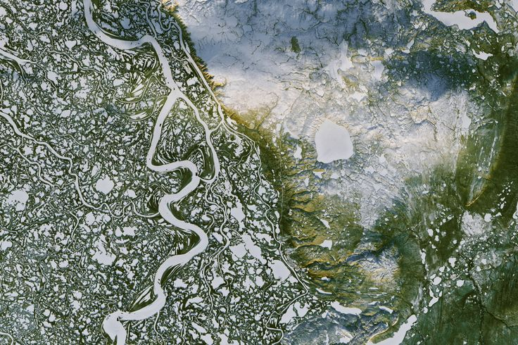 March 20 2017 : Mackenzie River in Canada's Northwest Territories This view acquired on Nov. 7 2016 by the Operational Land Imager (OLI) on Landsat 8 shows a portion of Canada's Mackenzie River Delta and the town of Inuvik home to more than 3000 people. A frozen highway -- 194 kilometers (120 miles) long -- runs between the remote outposts of Inuvik and Tuktoyaktuk along the rivers East Channel.