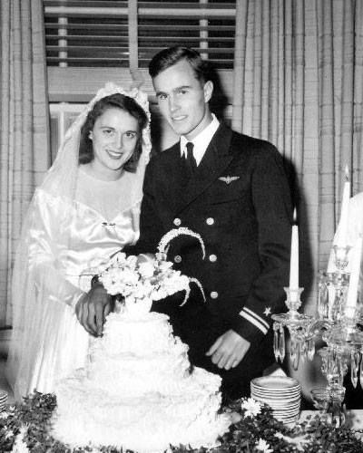 "Former President George Bush and his wife Barbara! ""They celebrate 70 years of marriage today, making them the longest-married First Couple. (The title was  previously held by John and Abigail Adams, who were married for 54 years.)  They met and married in Rye, New York. This photograph was taken on their wedding day on January 6, 1945.  George and Barbara Bush have five children, 24 grandchildren, and four great-grandchildren."""