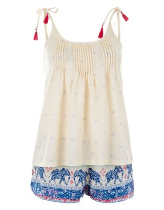 Get your snooze on with this boho-inspired pyjama set, featuring a jersey cami with all-over hearts and pin-tuck pleats, and elephant-print shorts with tasselled ties.