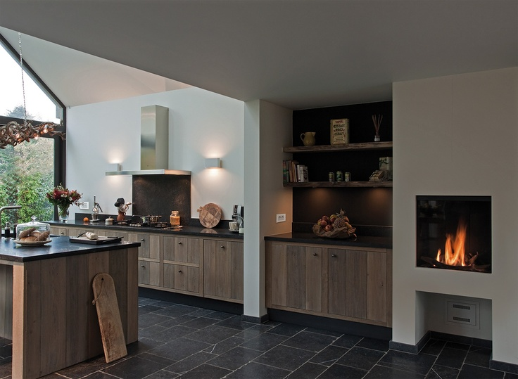 Modern rustic. Natural wood cabinetry great room with fireplace BTicino Axolute schakelmateriaal