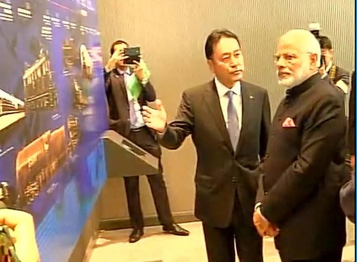 PM Narendra Modi arrives at the Kawasaki Heavy Industries with Shinzo Abe to get first hand info on bullet trains
