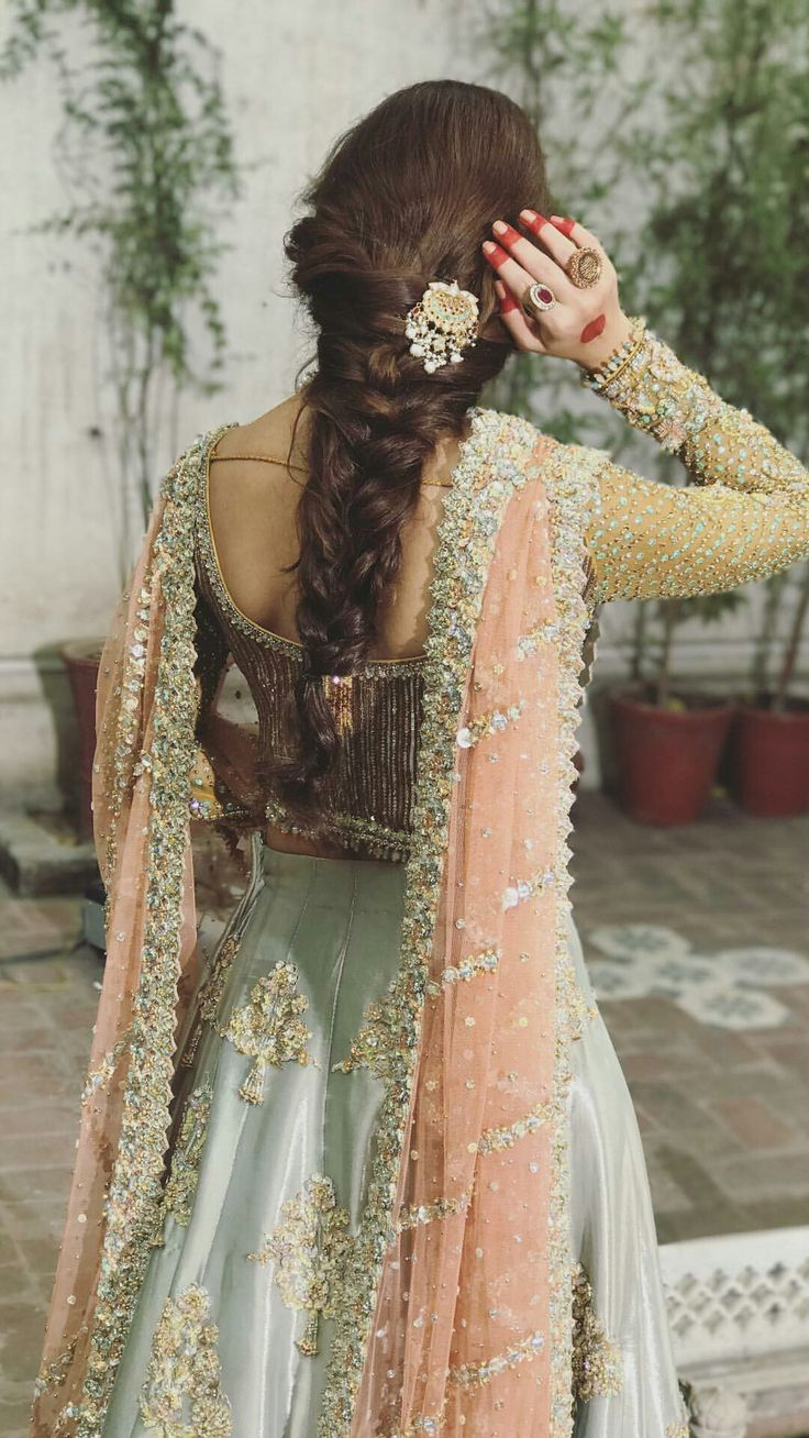 Sometimes heavy embellishments work wonders. And pastel hue are so delicate on the eyes. I like toh e hairstyle and basic mehendi as well. Striking.