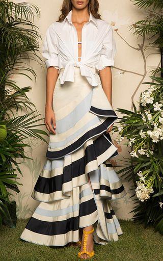 This **Johanna Ortiz** shirt features a tie hem and a pointed collar. Also enjoy the feminine skirt