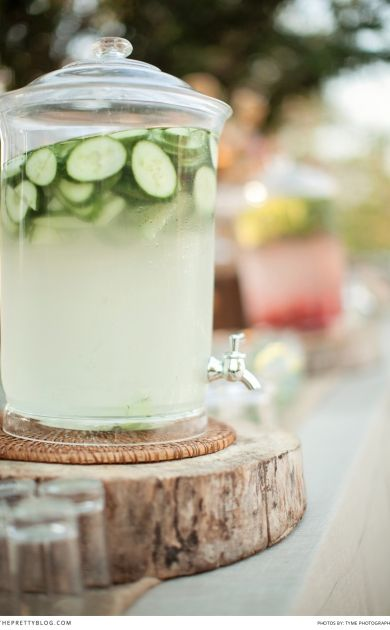 Have different types of cocktails or refreshing drinks in these dispensers for your guests | Photographers: Tyme Photography