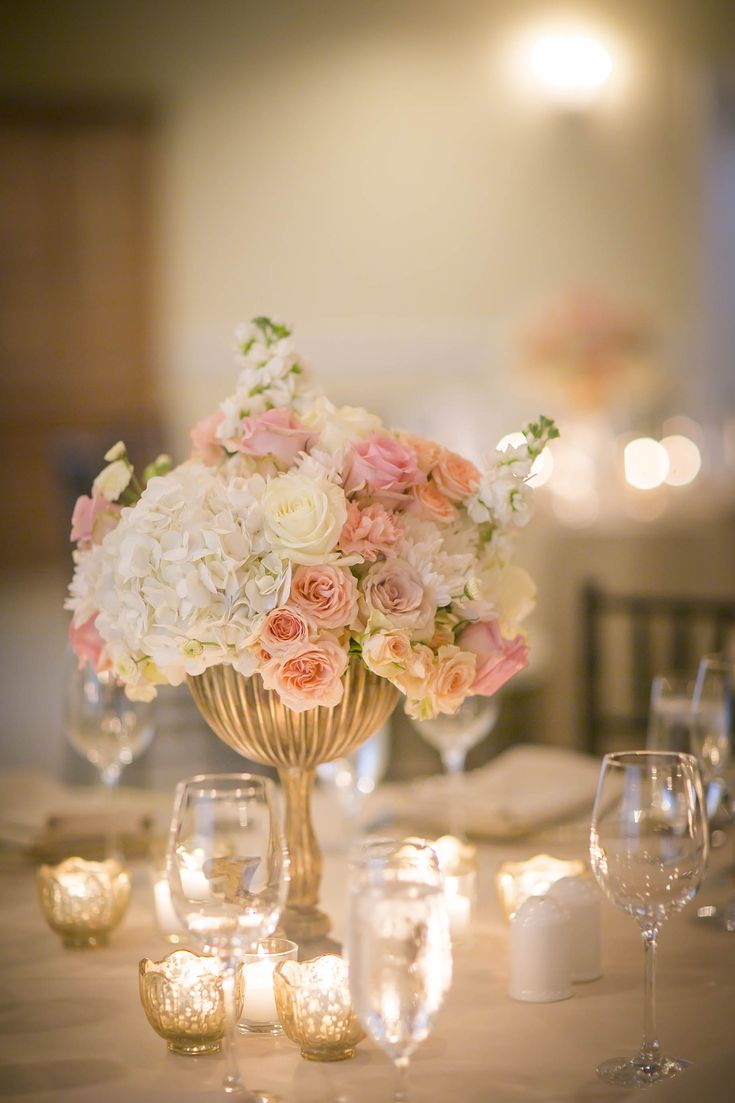 Candle lit reception with beautiful soft colors creating a romantic atmosphere. Shop this compote here: http://www.save-on-crafts.com/venice-compote-gold-lg.html