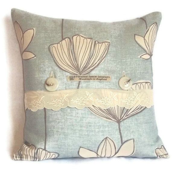 Handcrafted John Lewis Gingko fabric cushion cover with lace trim and button fastening £14.95