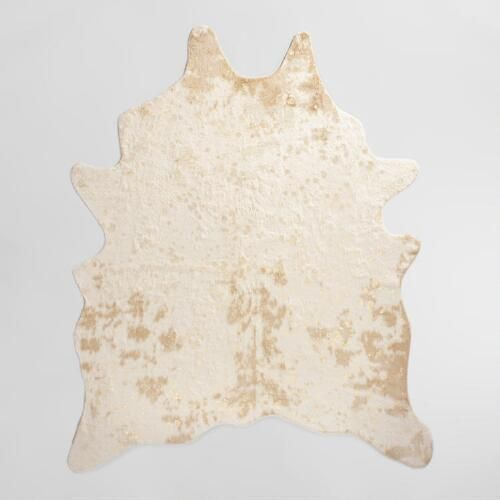 One of my favorite discoveries at WorldMarket.com: 5'x6'7' Gold Printed Faux Cowhide Area Rug
