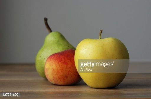 Stock Photo : Apple, peach and pear on table